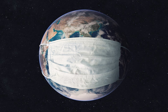 Earth planet in medicine mask fight against Corona virus. Concept of fight against epidemic and climate change. Pollution of the planet by exhaust gases. Elements of this image furnished by NASA
