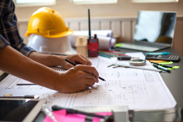 Concept Architect and desk of Architectural project in construction site or office building with mining light