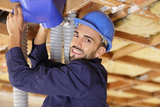 professional contractor installing air conditioning system