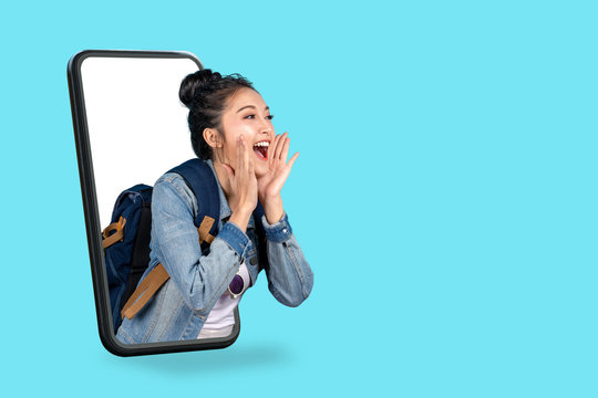 Smartphone pop up for advertising.Asian woman travel backpacker shouting open mouth through from screen mobile.Girl looking to aside copy space for present promotions.Digital marketing online cencept.