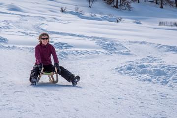Sledding on the slopes of Tarasp in the Swiss Alps