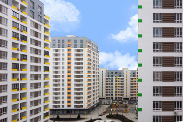 Modern urban architecture cityscape view under blue sky at daytime. Building facades with colored windows. Mortgage to buy private apartment concept