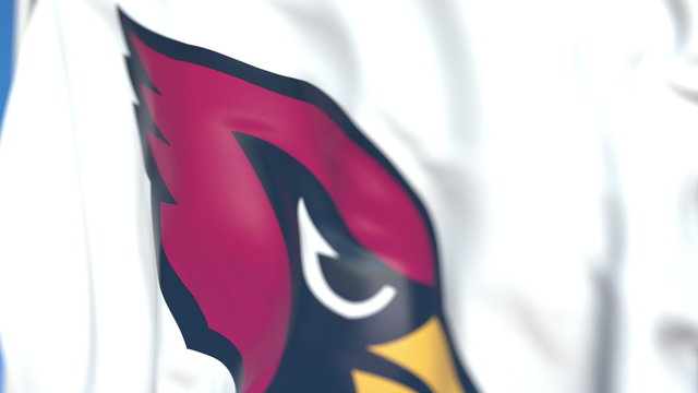 Flying flag with Arizona Cardinals team logo, close-up. Editorial 3D rendering