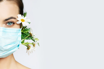 Stores à enrouleur Fleuriste Partial view of young woman in medical mask with flowers on white background.