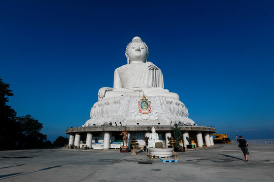 A tourist takes a photo of a Buddha statue at an area which is usually full of tourists, amid fear of coronavirus in Phuket