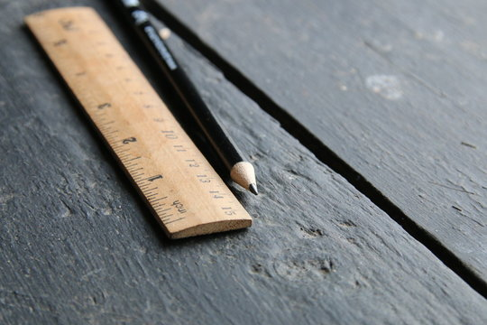 wooden ruler lies on a vintage table