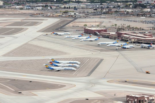 LAS VEGAS, USA - APRIL 15, 2014: Allegiant Air fleet at Las Vegas McCarran International Airport. Allegiant Air will replace all of its aging McDonnell Douglas MD-83 and MD-88 aircraft in 2018.