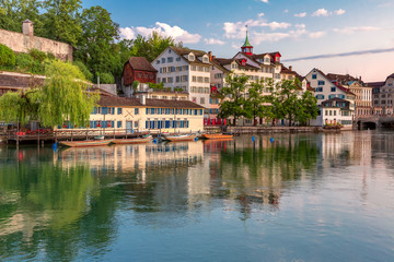 Fototapete - Cozy houses on Limmat river embankment at sunrise in Old Town of Zurich, the largest city in Switzerland