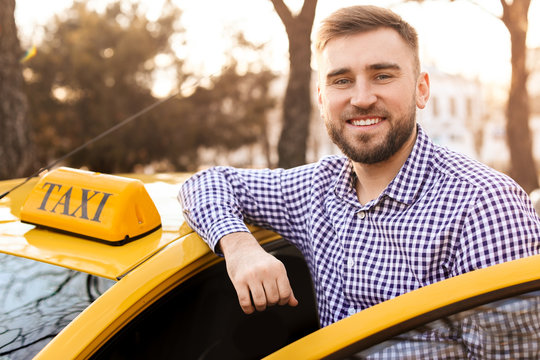 Portrait of handsome taxi driver outdoors