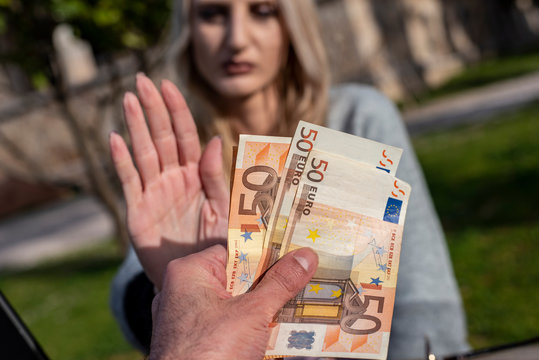 Blond female woman refuses to accept money
