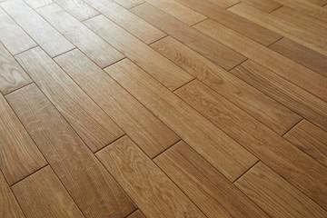 Obraz Natural wooden texture. New oak parquet. Wooden laminate floor boards background image. Polished oak pattern. - fototapety do salonu