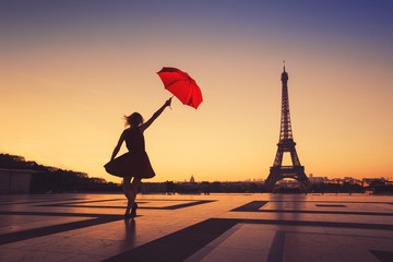 tourist travel to Paris, silhouette of happy woman with red umbrella near Eiffel Tower Fotomurales