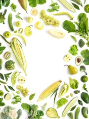 Fototapete - Frame of green vegetables and fruits isolated on white background, flat layout, top view.