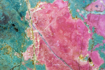 Rhodonite pink massive. Close-up of manganese inosilicate marble like surface
