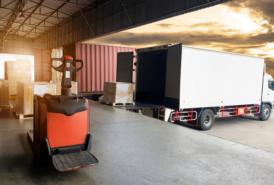 Truck container docking load shipment goods at warehouse, forklift   pallet jack with stack package boxes on pallet, road freight industry delivery logistics and transport.