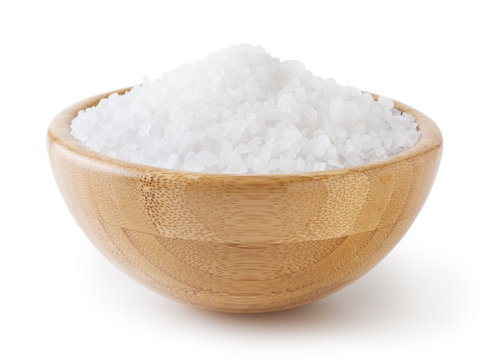 Sea salt in wooden bowl isolated on white background with clipping path