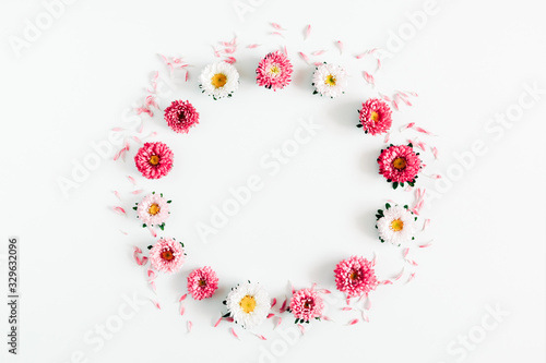 Beautiful flowers composition. Wreath made of pink and white flowers on white background. Valentines Day, Easter, Mother's day. Flat lay, top view, copy space