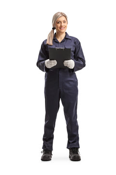 Female worker in an overall uniform holding a clipboard