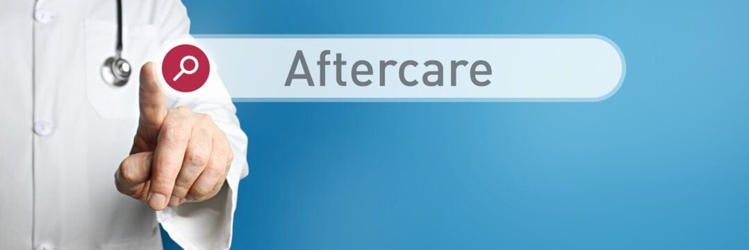 Aftercare. Doctor in smock points with his finger to a search box. The word Aftercare is in focus. Symbol for illness, health, medicine