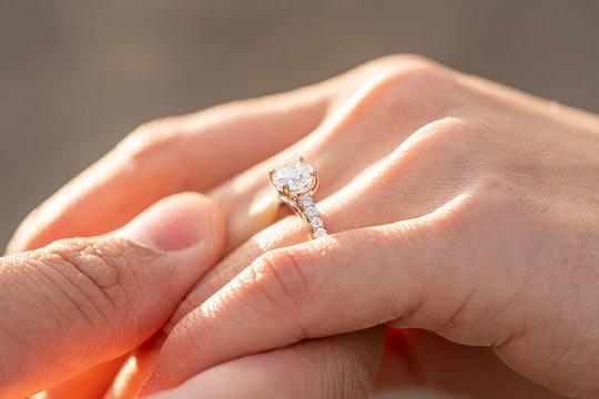 diamond ring in hand