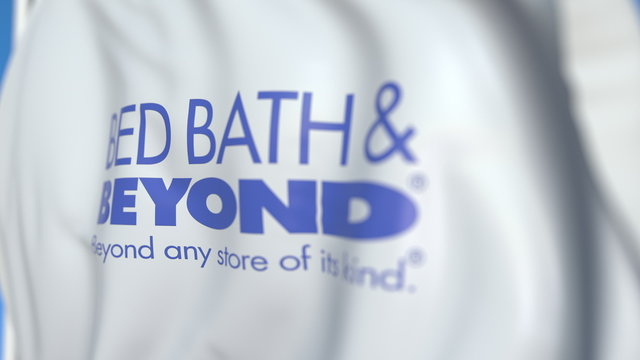 Flying flag with Bed Bath & Beyond logo, close-up. Editorial 3D rendering