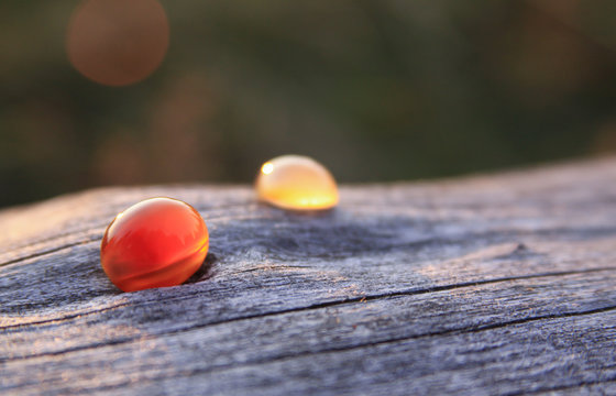 Two chalcedony agate gemstone on wooden background