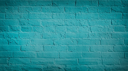 Blue teal brick wall background. Neutral texture of a flat brick wall close-up.