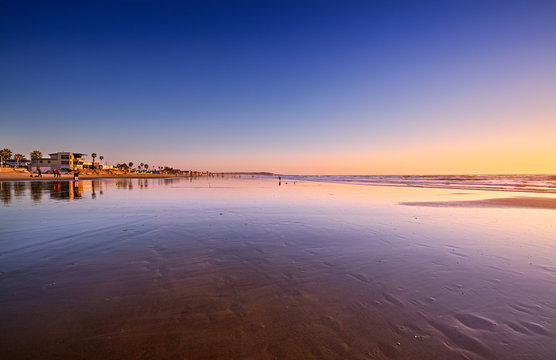 View South on Pacific Beach towards Mission Beach at low tide on a sunny Winter evening