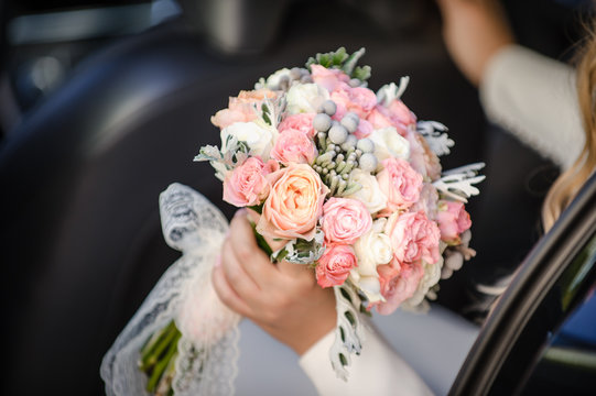 beautiful modern wedding bouquet in bride's hand. Girl in a white wedding dress. Love and tenderness.