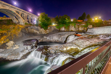 Late night long exposure shot of the Spokane Falls and Bridge in the Riverfront Park area of Spokane, Washington, USA.