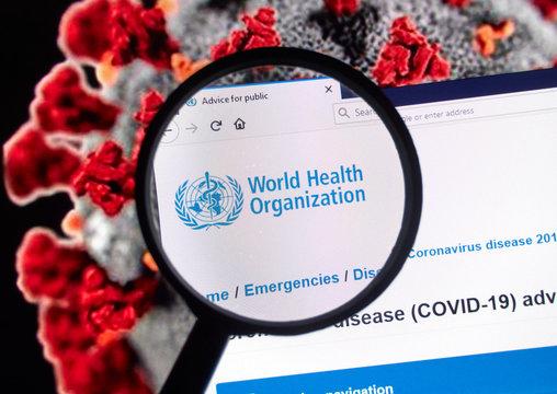 World Health Organisation logo over Coronavirus picture