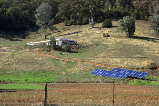 Sustainable living, solar panels supplying power for off grid living.