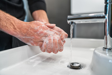 Fotorollo Wanddekoration mit eigenen fotos Corona virus travel prevention man showing hand hygiene washing hands with soap in hot water for coronavirus germs spreading protection.