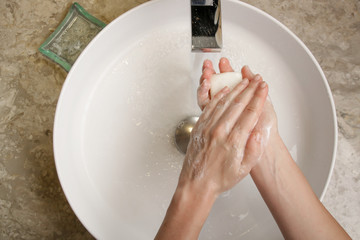 Hygiene. Cleaning hands with soap and water. Washing hands on sink. Preventing diseases by washing...