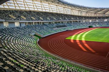 Panoramic view of soccer field stadium and stadium seats