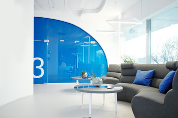 Modern office with cozy lobby furnished with sofa and coffee tables, interior with blue elements