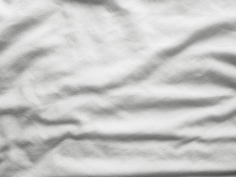 Soft white wrinkled fabric background