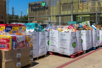 Houston, Texas - March 11, 2020: Local charities, food banks preparing quarantine food kits, medicine and basic disinfecting supplies to individuals, families in need during national health emergency