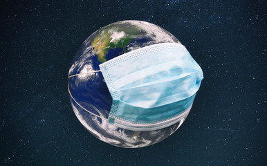 The planet earth is wearing a protective mask in the space. Concept of quarantine, protection from viruses and pandemic. Elements of this image furnished by NASA Fototapete