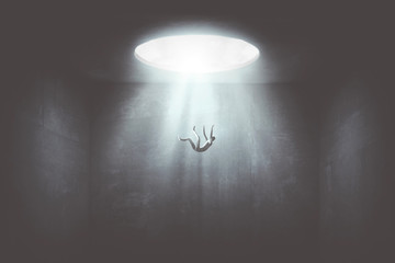 man falling down from a hole of light, surreal concept