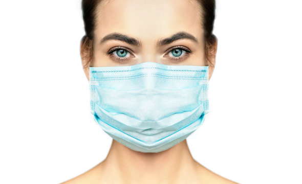 Cropped image of beautiful woman in protection medical mask.