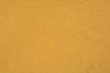Wide shot of a concrete surface painted in a pale orange color