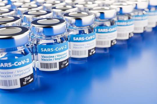 Concept for availability of enough vaccine against new corona virus SARS-CoV-2: Rows of glass container of vaccination. The word vaccination in English, Spanish, French and German on the label