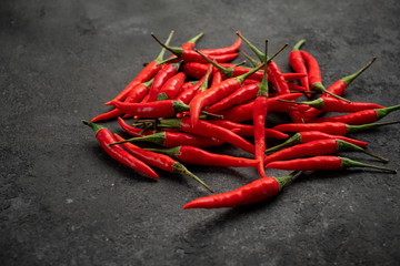 Canvas Prints Hot chili peppers pile of Red chili peppers on a black stone