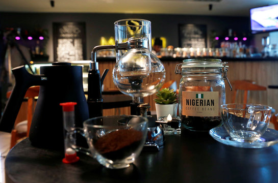 A jar of Nigerian coffee beans is pictured with a siphon brewing set at Mai Shayi cafe in Victoria Island, Lagos