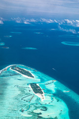 Tropical islands and atolls in Maldives from aerial view. Aerial view of Maldives island and blue ocean background