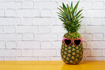 pineapple wearing heart-shaped sunglasses.
