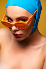 sexy naked fashionable girl in scarf and trendy sunglasses, isolated on yellow