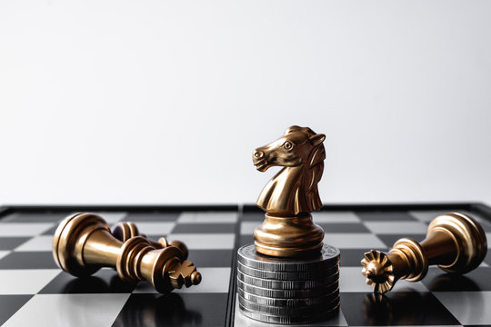 A chess knight last stand as a true winner.Money game concept. Copy space.