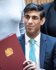 Britain's Chancellor of the Exchequer Rishi Sunak is pictured with the signed West Yorkshire Combined Authority devolution deal during a visit to the Nexus Building at the University of Leeds, in Leeds